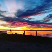 Sunset on the Great Slave Lake in Hay River by 2 Seasons Adventures campgrounds and yurt.