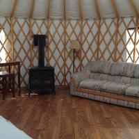 The couch and bed inside 2 Seasons Adventures yurt in Hay River.