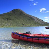 Northern Nature Photography's picture of two red canoes on the water in the Nahanni National Park in the Northwest Territories.