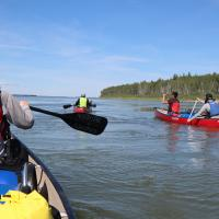 Four paddlers with North Star Adventures paddling the Mackenzie River.