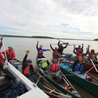 A group of North Star Adventures paddlers in canoes on the Mackenzie River, NWT.