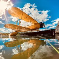 Yellow float plane on the dock on a sunny day in Yellowknife, NWT.