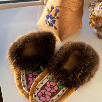 Fur moccasins with beads in the Snowshoe Inn gift shop in Fort Smith, NWT.