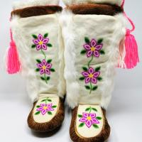 A pair of white mukluks with pink beaded flowers from Caribou Creations, Lutsel K'e, NWT.
