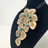 Sliced Caribou antler necklace with turquoise beads at Caribou Creations in Lutsel K'e, NWT.