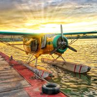 Buffalo Airways float plane with sunset in Yellowknife NWT.