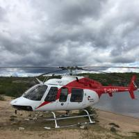 Acasta Heliflight helicopter landed at Acasta River in the NWT.