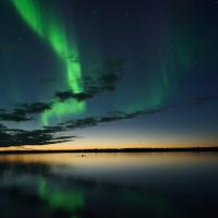The northern lights dance above the open waters of Great Slave Lake in the Northwest Territories