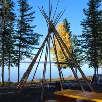 View of Mackenzie River and teepee from Mackinnon Park in the Northwest Territories