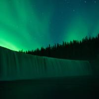 The Northern lights dance above Lady Evelyn Falls in the Northwest Territories
