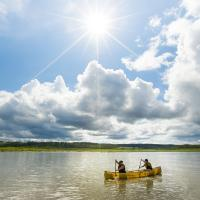 people paddle on the Mackenzie river in the NWT