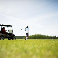 Golfers at the Seven Spruce Golf course in Fort Simpson in the NWT