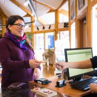 A person interacts with staff at the Acho Dene Native Crafts store in the NWT