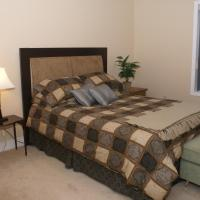 Cambridge Executive Suites comfortable room with a single bed in Hay River Northwest Territories.