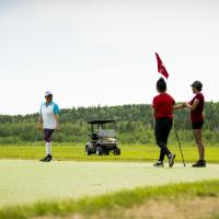 People pay golf at the Fort Simpson in the Northwest Territories