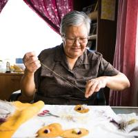 A crafts person beading traditional indigenous crafts in  Jean Marie River in the Northwest Territories