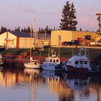 Boats on the water in the town of Hay River in the Northwest Territories