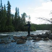 Here fishy fishy - a man casting his line fly fishing at Watta Lake Lodge in the Northwest Territories.