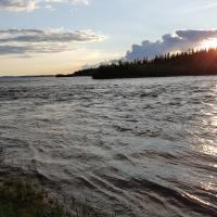 A man fishing on the East Arm of the Great Slave Lake in the Northwest Territories.