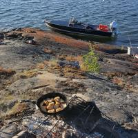 East-Arm pop-up camp east-arm of the Great Slave shore side fish fry lunch in the Northwest Territories.
