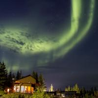 Aurora blazing across the night sky at Frontier Fishing Lodge in the Northwest Territories.