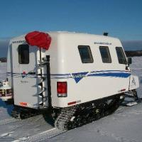 Bluefish Services parked snobear machine for ice fishing in a vehicle over the frozen Great Slave Lake in Yellowknife Northwest Territories.