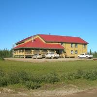 Grey Goose Lodge exterior photo in Deline on a sunny day in the Northwest Territories.