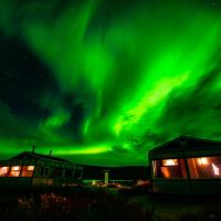 Aurora ablaze over Peterson's Point Lake Lodge guest cabins