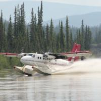 Air Tindi De Havilland Canada DHC-6 Twin Otter landing on water in Northwest Territories Canada.