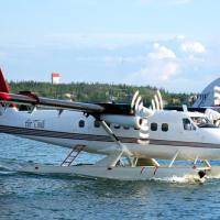 Air Tindi De Havilland Canada DHC-6 Twin Otter on water getting ready to fly on a sunny day Yellowknife Northwest Territories.