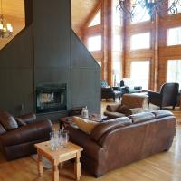 The luxury lounging area and stand alone fire place at Ena Lake Lodge with a lot of sunlight at the 60th parallel.