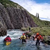 Three canoes lining rapids in the Northwest Territories on a trip with Black Feather