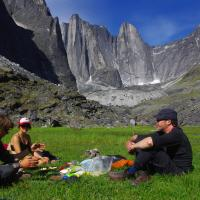 Three people having a lunch break on the Fairy Meadows in Nahanni National Park Reserve - Black Feather