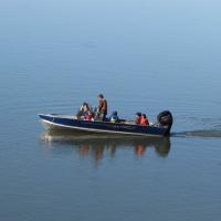 K'iyeli Tourism Services people on a speed boat on the Mackenzie River in the Northwest Territories