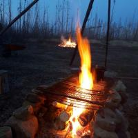 A glowing fire at dusk in Fort Simpson, Northwest Territories.