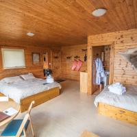 Scott Lake Lodge beautiful wooden cabin interior with two beds.