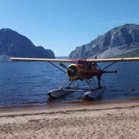 Float Plane on the water of Little Doctor Lake in the Nahanni by Nahanni Mountain Lodge in the NWT.