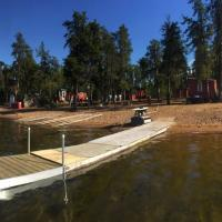 North Star resort cabins and dock with a sandy beach in the Northwest Territories.