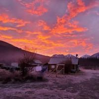 Canol Outfitters cabin under the fiery sunset in Norman Wells in the NWT.