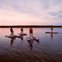 Four men riding water bikes with AuroraTours.net in Yellowknife on the Great Slave Lake.
