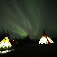 Glowing teepees by Auroratours.net at their teepee camp near N'dilo.