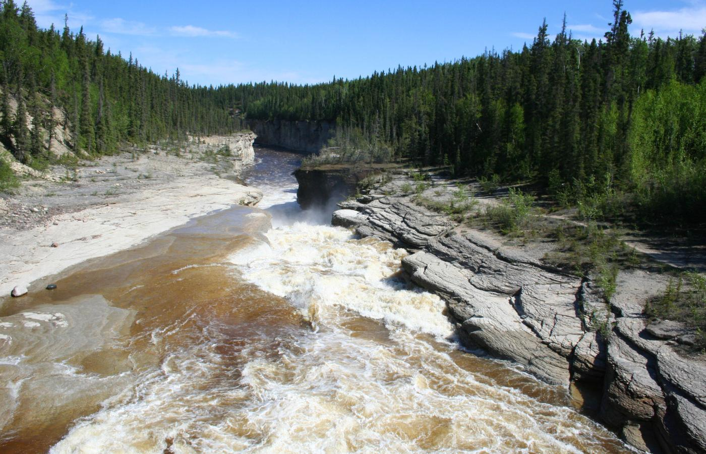 Sambaa Deh Falls in Canada's Northwest Territories are a scenic and archeological marvel.