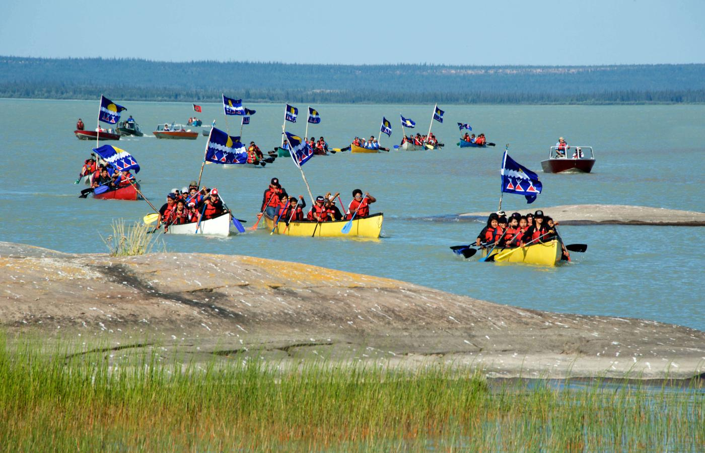 Canoes in the water near Behchokǫ̀
