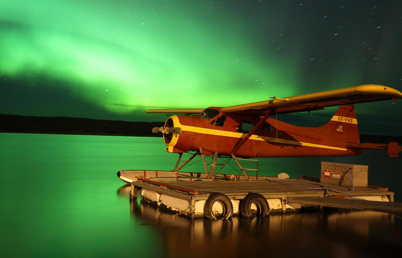 Aurora and float plane on the Mackenzie River, Fort Simpson
