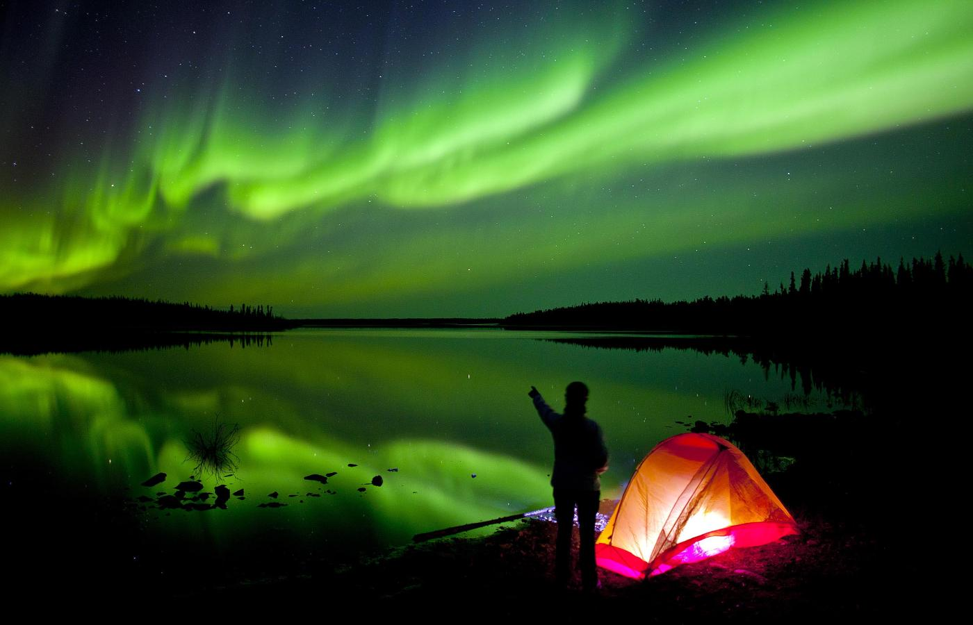 The aurora over Peterson's Point Lake Lodge in the Northwest Territories