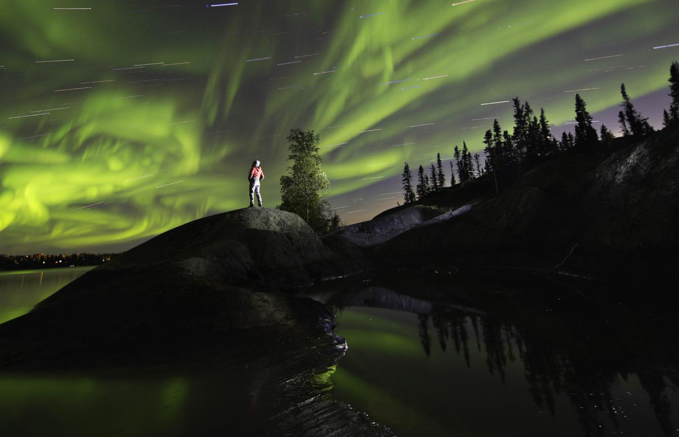 The Aurora Borealis blazes out over the landscape in the Northwest Territories