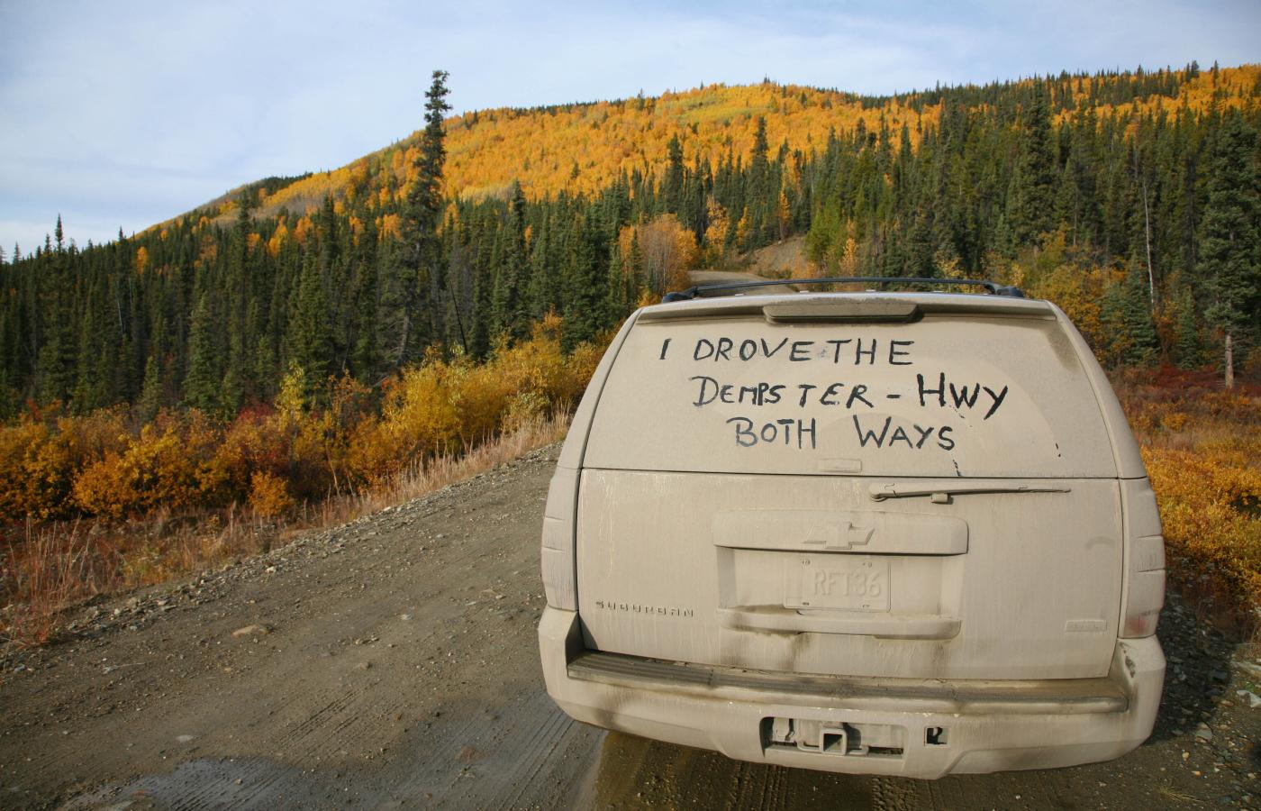 Vehicle showing the dust on the Dempster Highway