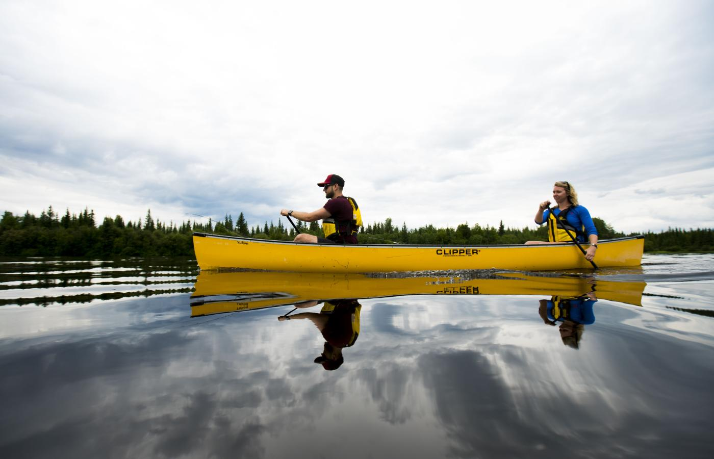 Couple paddling in canoe on the Mackenzie River