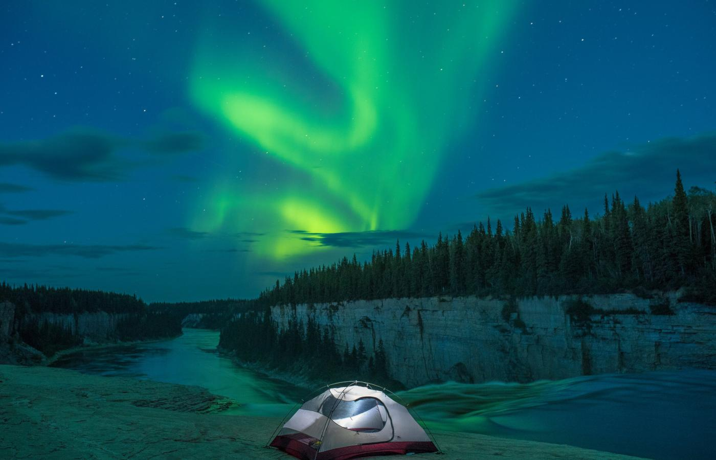 Horton River camping in a tent with the Northern Lights in the sky above
