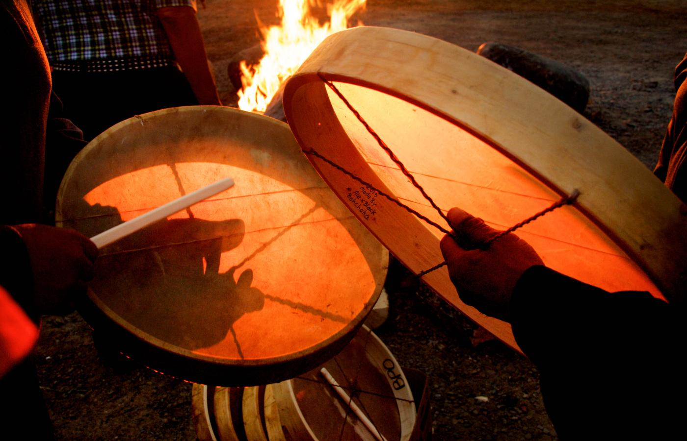 Dene drums by the fire